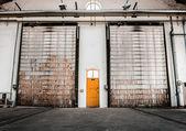 Between normal yellow two door shutter door — Stock Photo