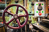 Old industrial tool wheel and buttons — Stockfoto