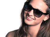 Young beautiful woman wearing sunglasses — Stock Photo