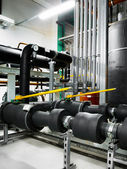 Insulated pipeline in industrial interior — Stock Photo
