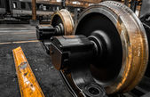 New locomotive wheels in vehicle repair station — Stock Photo