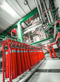 Large CO2 fire extinguishers in industrial interior — Stock Photo