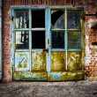 Old rusty iron door glass brick wall — Stock Photo #27778419