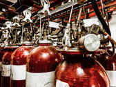 Large CO fire extinguishers in industrial interior — Stock Photo
