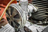 Old worn out air filter with a engine — Stock Photo