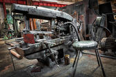 Old industrial metal sawing machine to a repair shop — Stock Photo