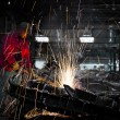 Worker in factory cutting steel pipe using metal torch — Stock Photo