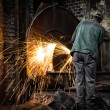 Worker in factory cutting steel pipe using metal torch — Stock Photo #30768457