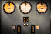 Old industrial electronics gauge instruments in a firm — Stock Photo