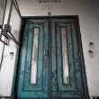 Old, worn, painted door — Stockfoto