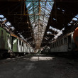Train wreck in an abandoned warehouse — Stock Photo
