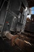 Train wagons in an abandoned warehouse — Stock Photo