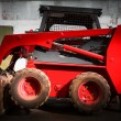 Skid loader in garage — Stock Photo