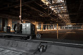 Old abandoned industrial interior bright light — Foto Stock