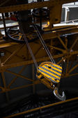 Yellow crane close up in factory — Stock Photo