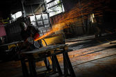 Electric wheel grinding on steel structure — Foto de Stock