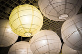 Hanging white and yellow paper lanterns — Stock Photo
