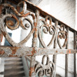 An old rusty wrought-iron railing — Stock Photo #40335027