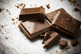 Broken pieces of chocolate — Stock Photo