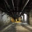 Inside an old industrial building, basement — Stockfoto