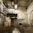 Old industrial building, basement with little light — Stok fotoğraf