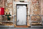 Old industrial building exterior wall, door  — Stock Photo