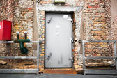 Old industrial building exterior wall, door  — Stockfoto