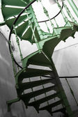 Old metal spiral stair in a factory — ストック写真