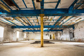 Old industrial building interior, support structure — Stock Photo