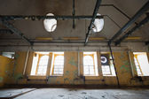 An old industrial building interior, windows — Photo