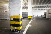 An old empty industrial warehouse interior — Stockfoto