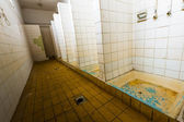 Bathroom of an old abandoned factory  — Stock Photo