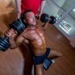 Stock Photo: Training in gym where partner gives encouragement