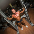 Stock Photo: Bodybuilder doing squat with barbell