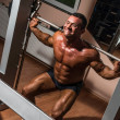 Stock Photo: Body builder doing squat with barbell