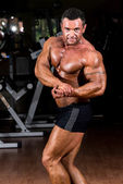 Muscular bodybuilder showing his side chest — Stock Photo