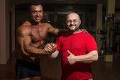 Portrait of bodybuilder and training partner — Stock Photo