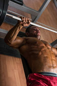 Shirtless body builder doing bench press for chest — Stock Photo
