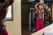 Body builder showing abs — Stock Photo