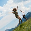 Mother and son jumping in meadow — Stock Photo #27233905