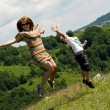 Mother and son jumping in meadow — Stock Photo #27233955