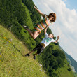 Mother and son jumping in meadow — Stock Photo #27234005