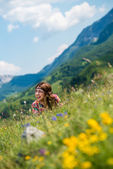 Beautiful women laughing and lying on the grass — Stock Photo