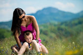 Mother and son sitting and playing — Stock Photo