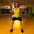 Woman doing fitness exercises with dumbbells — Stock Photo