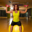 Woman doing fitness exercises with dumbbells — Stock Photo #29492201