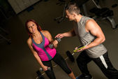 Woman and Man Exercise in the Gym — Stock Photo