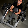 Handsome muscular man exercising in Gym — Stock Photo