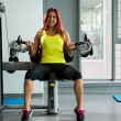 Foto Stock: Womdoing exercise for triceps