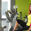 Young woman training on an exercise bike — Stock Photo